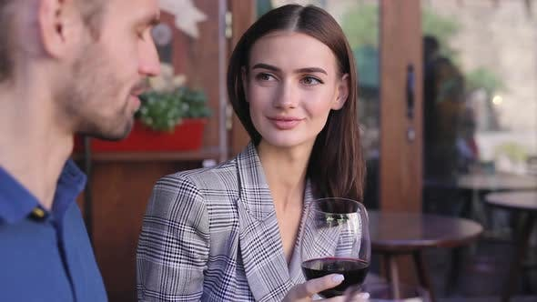 Couple Drinking Wine On Date At Restaurant, People With Drink