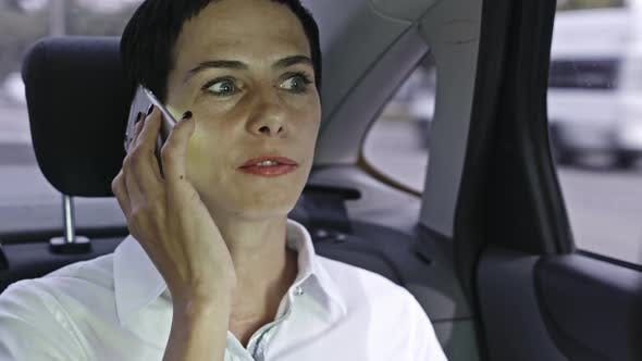 Cover Image for Woman Talking on Phone in Car