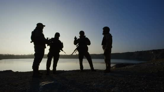 Cover Image for Equipped and Armed Soldiers Ready for a Mission