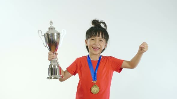 Little Girl Rejoicing With Trophy