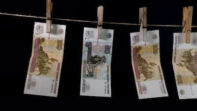 Russian Rubles Dry on a Clothespin Rope