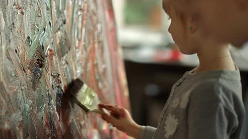 Focused Children Studying in Art Studio