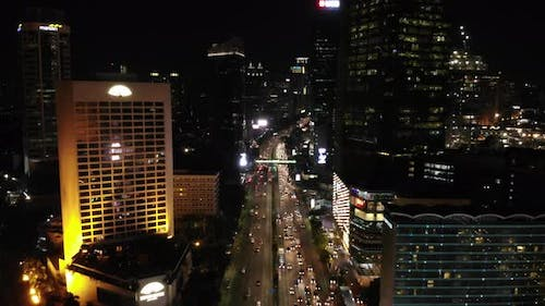 Ungraded Aerial Footage of A City at Night With Traffic