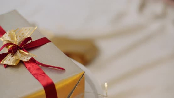 Thumbnail for Closeup Of Christmas Gift Box Tied With Ribbon