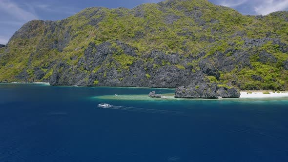 Thumbnail for Aerial View of Strait Near Matinloc Island in El Nido, Palawan, Philippines. Toursit Outrigger Boat