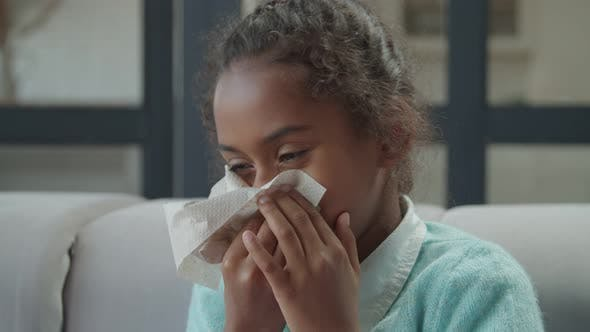 Sick Girl Blowing Her Runny Nose Into Tissue Paper