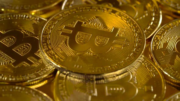 Thumbnail for Premium Gold Coins Are the Cryptocurrency Bitcoin Slowly Rotates in a Circle. Macro Shot of Rotating