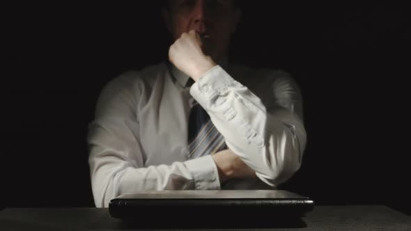 Businessman Is Shutting Burning Laptop And Worried