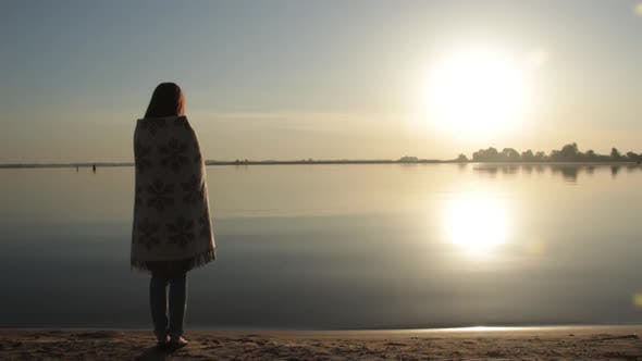 Thumbnail for Woman Standing Near the Sea Shore at Dawn
