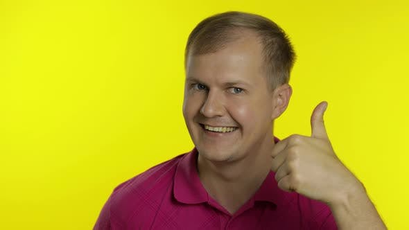 Thumbnail for Portrait of Caucasian Man Posing in T-shirt. Smiling Handsome Guy Show Thumb Up. People Emotions
