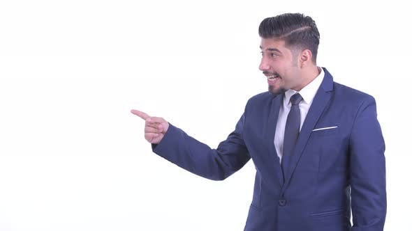 Thumbnail for Happy Bearded Persian Businessman Snapping Fingers and Looking Excited
