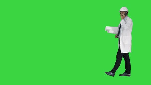 Thumbnail for Business Man Computer Science Engineer Talking By Cellphone While Walking on a Green Screen