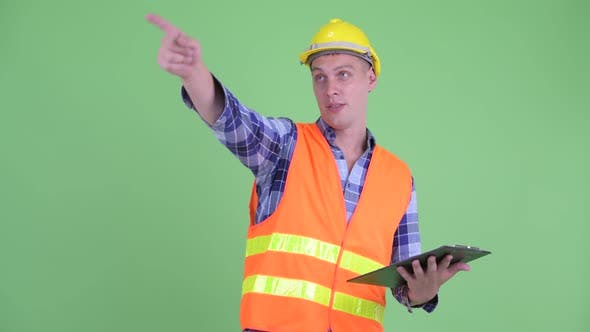 Thumbnail for Happy Young Man Construction Worker Directing While Holding Clipboard