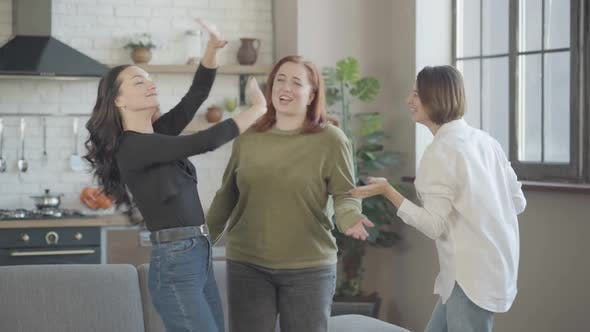 Thumbnail for Three Cheerful Women Dancing in Kitchen at Home