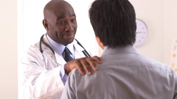 African American doctor talking to Hispanic patient