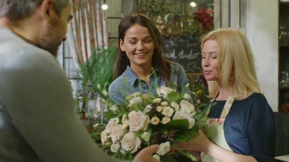 Thumbnail for Two Florists Selling Floral Arrangement