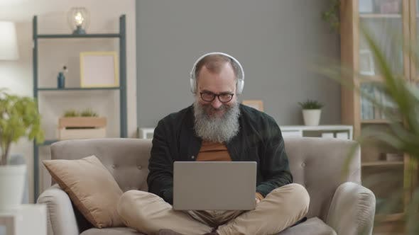 Cheerful Old Man Enjoying Music