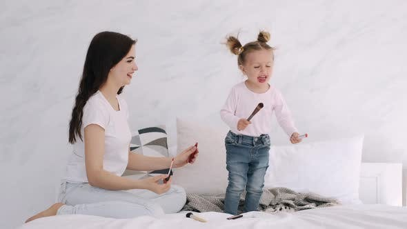 Thumbnail for Mother and Toddler Daughter Are Doing Make-up and Having Fun