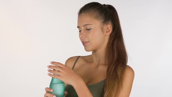 Thumbnail for Gorgeous Woman Enjoying Drinking Water From a Bottle, Isolated
