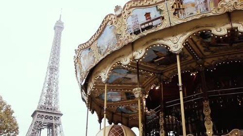 Carousel in Park near the Eiffel Tower in Paris, France, Europe.