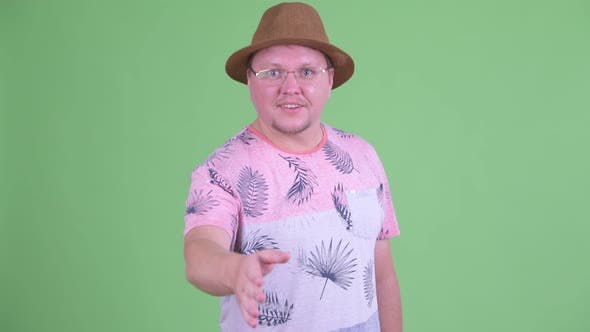 Thumbnail for Happy Overweight Bearded Tourist Man Giving Handshake