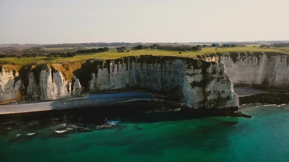 Thumbnail for Idyllic Aerial Landscape View of Sunset Azure Sea Shore and Famous Normandy White Rocky Cliffs