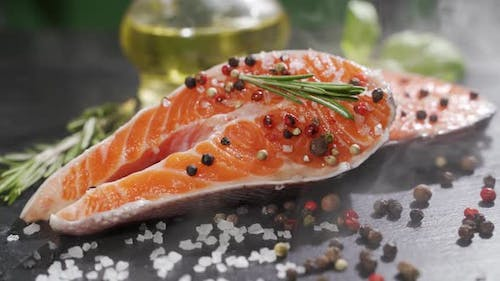 Close Up View of Seasoning Process of Salmon's Fillet.