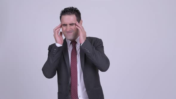 Thumbnail for Stressed Businessman Having Headache Against White Background