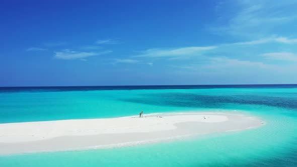 Thumbnail for Wide above tourism shot of a sunshine white sandy paradise beach and aqua blue water background in v
