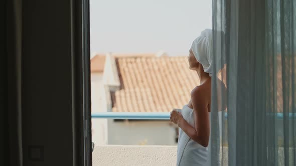 Thumbnail for Woman After Shower Enjoying Coffee on the Hotel Balcony