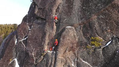 Two Climbers Climb the Wall at High Altitude