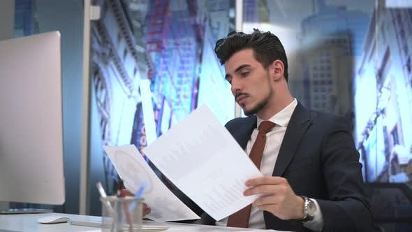 Businessman analyzing charts