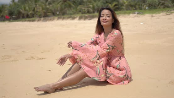 Thumbnail for Barefoot Ethnic Woman Sitting on Beach