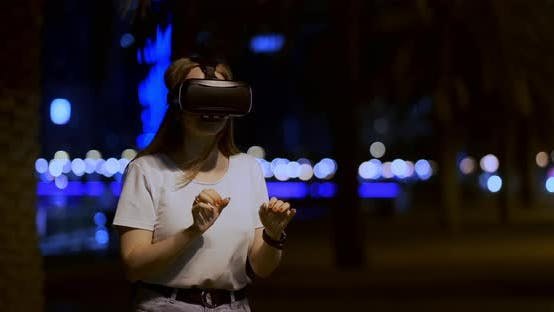 Thumbnail for Young Girl in Virtual Reality Glasses in a Big Metropolis