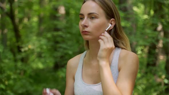 Thumbnail for Young Girl Is Put on Earphones and Runing in Park in Summer, Healthy Lifestyle.