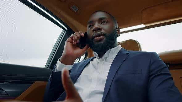 Thumbnail for Portrait of Business Man Talking Phone at Car. Afro Man Having Phone Call at Car