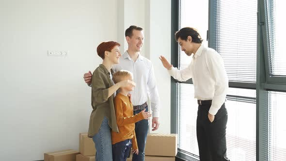 Happy Young Man Taking Bunch of Keys By Real Estate Agent to Own Flat After Making Successful