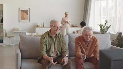Senior Men Chatting on Couch