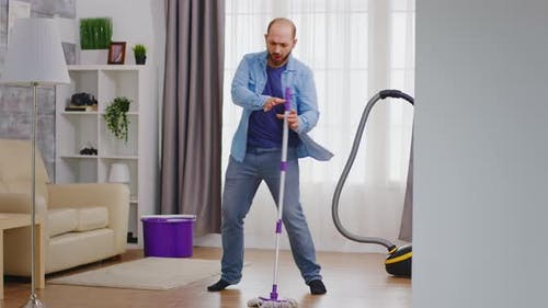 Funny Man Cleaning Apartment