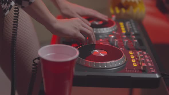 Thumbnail for Unrecognizable Woman Using DJ Controller at Party