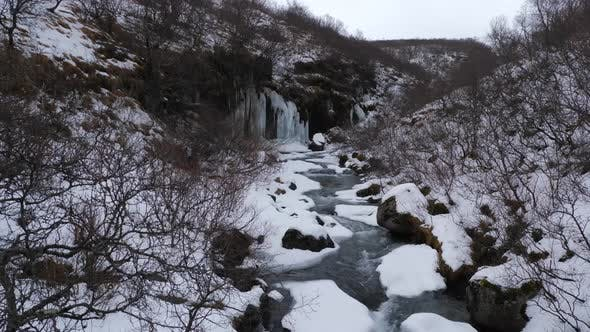Thumbnail for Snow Covered Valley With Rushing Water In Iceland During Winter 1