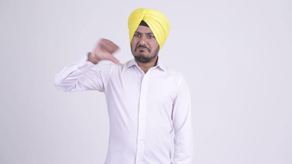 Thumbnail for Angry Bearded Indian Sikh Businessman Giving Thumbs Down