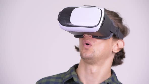 Cover Image for Face of Handsome Hipster Man Using Virtual Reality Headset