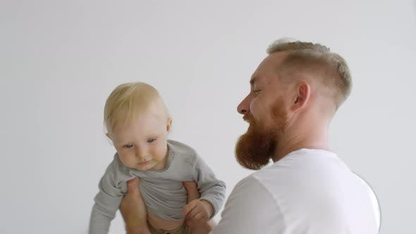 Father with Baby Twirling