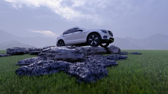 Thumbnail for White Luxury Off-Road Vehicle Standing on Rocks in Rainy Weather