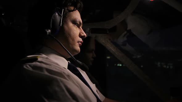 Thumbnail for Night Voyage Over the City, Attentive Pilot Steering Airliner Professionally