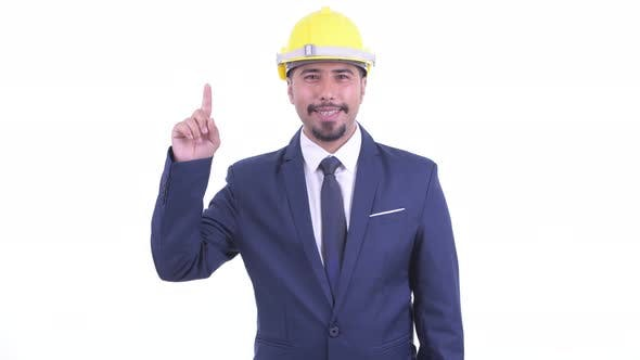 Happy Bearded Persian Businessman As Engineer Pointing Up