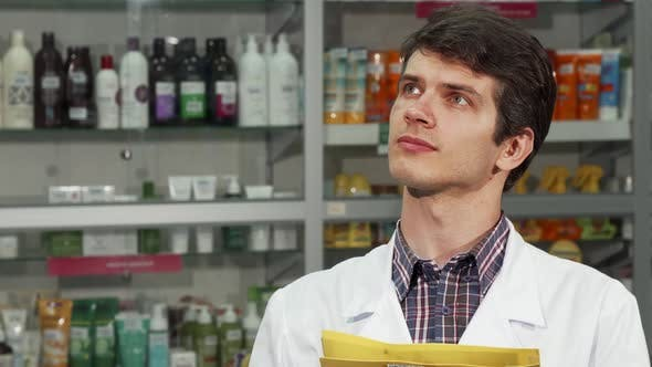 Thumbnail for Male Pharmacist Doing Inventory at the Drugstore