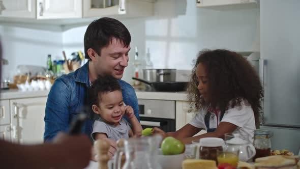 Thumbnail for Happy family at breakfast