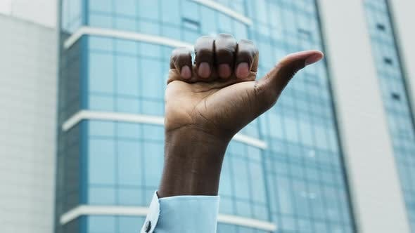 Thumbnail for Black African Man Holding Up Hand at Demostration Protest. Social Justice and Peaceful Protesting